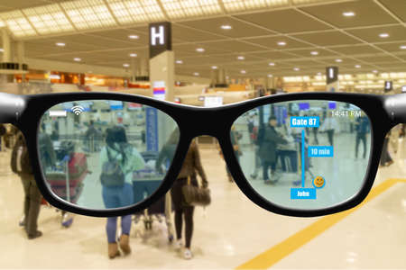 Futuristic technology trend concept in smart glasses.user use smart glasses with augmented mixed virtual reality while go to airport to get data check in boarding take off time gate number