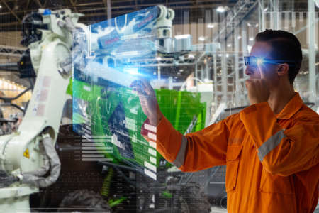 smart factory which use futuristic technology which combine big data, iot, 5g, machine deep learning, automation robot, augmented mixed virtual reality, digital twin, artificial intelligence