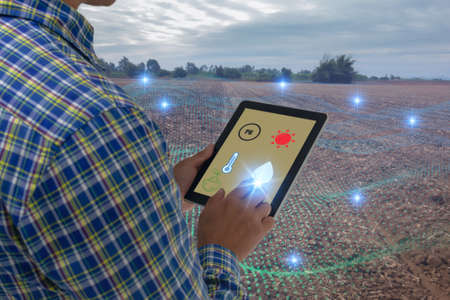 smart agriculture concept, farmer use tablet read infrared in soil with high definition soil mapping while planting,conduct deep soil scan during a tillage pass include organic, ec,om,Nitrogen,seed
