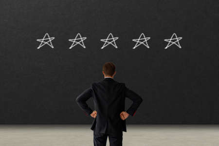business man looking on black board excellent rating voting by customer experience with hand putting highest rate five star. best services concept. copy space