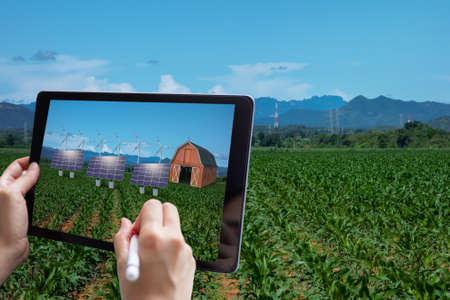 smart agriculture , industry 4.0, 5.0 technology concept. farmer use augmented mixed virtual reality technology to manage and simulation to install equipment in the farm predict, analytic how to fit Banco de Imagens