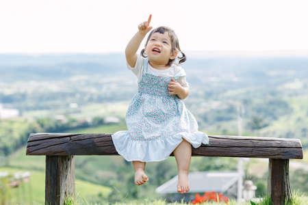 The little girl Running for fun in the garden.