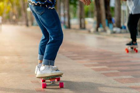 An Asian man's legs are seen standing on a skating surf skating event on the Bangsaen beachfront promenade. Thailand Standard-Bild