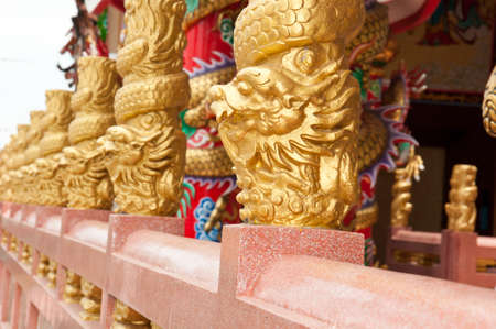 Beautiful golden dragon pillars in Chinese temple,Thailand photo