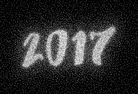 new years background: Glitter silver textured inscription 2017 of sprinkled confetti.