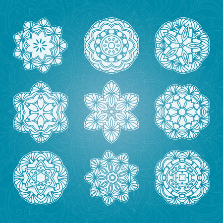 Set of hand drawn lace white pattern on blue background. Ethnic decorative mandala. Illustration