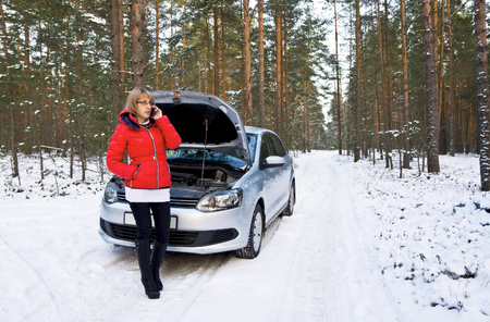 road assistance: Winter car breakdown,  Woman call for help, road assistance  Stock Photo