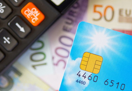 Euro money with calculator and credit card  photo