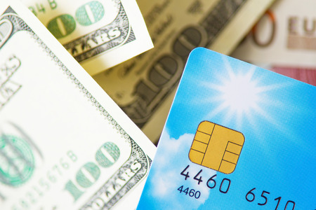 Dollar money with credit card photo