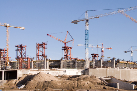 buildings under construction with cranes