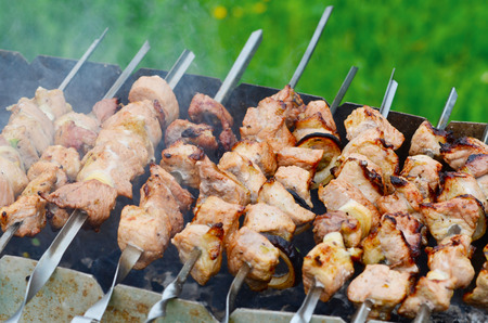 grilled barbecue in smoke  photo