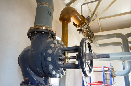 Place in a large industrial boiler room. Parts replaced during repair work photo