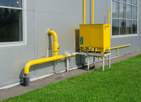 Industrial gas meter yellow box and pipes