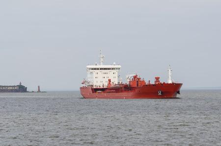 Cargo ship sailing in still water. Baltic sea photo