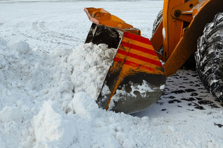 snow clearing: Clearing the road from snow. Winter in Russia