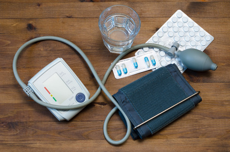 medicaments: Water glass, tonometer, thermometer, and medicaments on table