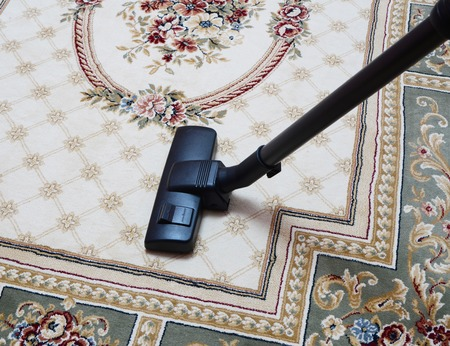 carpet vacuuming with vacuum cleaner at home Standard-Bild