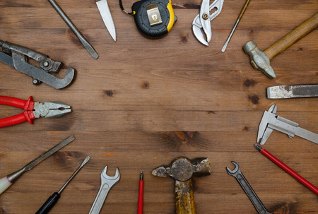 Set of tools on old wooden table.