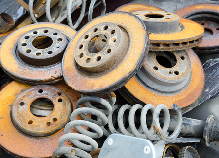 worn out: Useless, worn out  rusty brake discs and springs Stock Photo