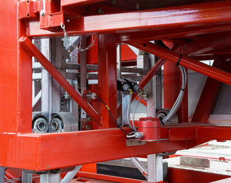 oiled: elements of the lifting platform red color