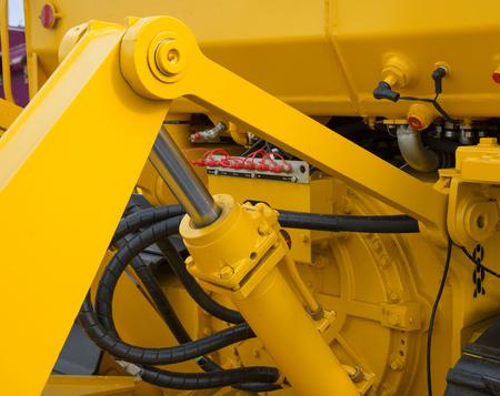 earthmover: Detail of hydraulic bulldozer piston excavator arm.