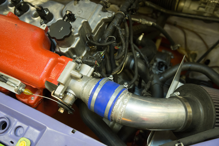 attachments: Details of old sports car engine and attachments