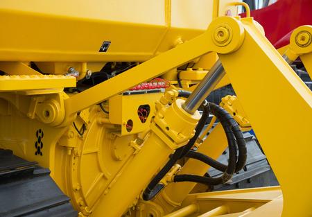 Particolare del bulldozer idraulica braccio dell'escavatore pistone