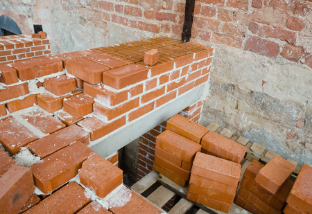 clay brick: Mason bricklaying background with clay brick blocks Stock Photo