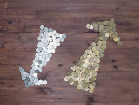 silver coins: Business Abstract background. gold and silver coins arrow on  wooden table