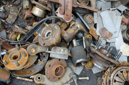 metal parts: Useless, worn out rusty brake discs and other parts