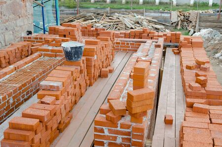 clay brick: Mason bricklaying background with bucket of clay brick blocks Stock Photo