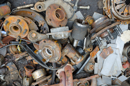 Useless, worn out rusty brake discs and other parts