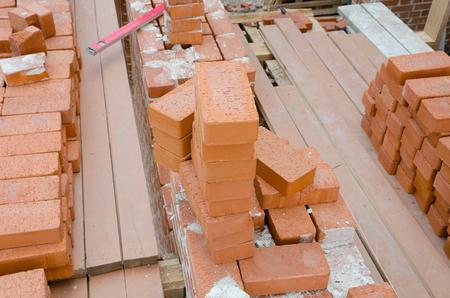 brick mason: Mason bricklaying background with clay brick blocks Stock Photo