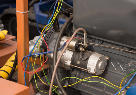 impermanent: photo of engine starter connected with impermanent wires Stock Photo