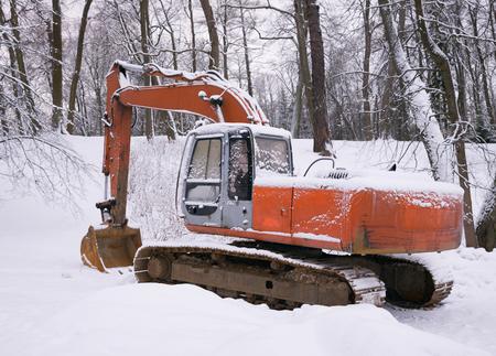 after work: Excavator near Winter Park left after work Stock Photo