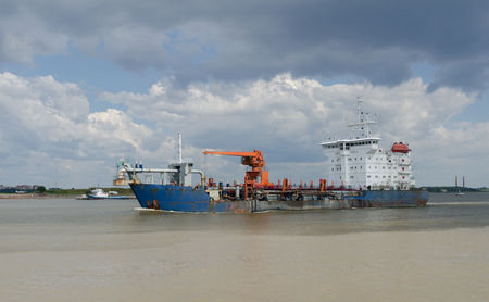 still water: big Cargo ship sailing in still water
