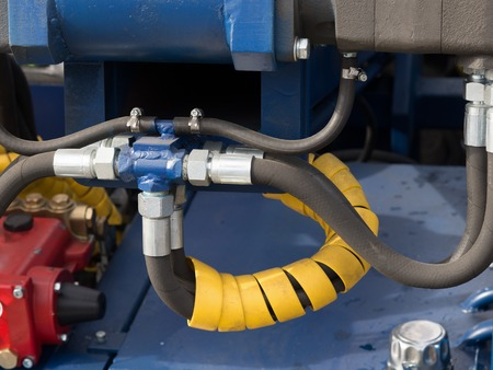 hydraulic hoses: Hydraulic tubes, fittings and levers on control panel of lifting mechanism
