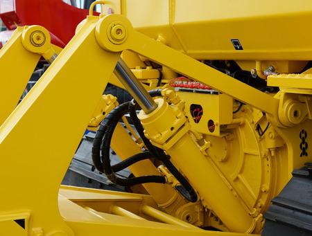 earthmover: Detail of hydraulic bulldozer piston excavator arm