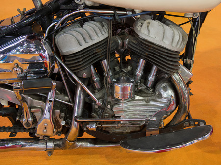 carburetor: Closeup of a motorcycle engine and attachments