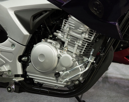 attachments: Closeup of a motorcycle engine and attachments