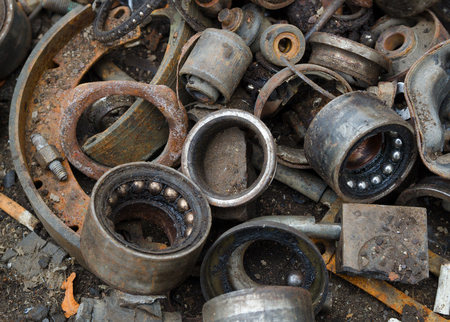 metal parts: Useless, worn out rusty brake discs shock absorber and other parts