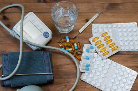 tonometer: Water glass, tonometer, thermometer, and medicaments on table