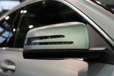 rear view mirror: Rear view mirror of new gray car