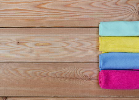 rags: Multicoloured rags for cleaning on wooden table