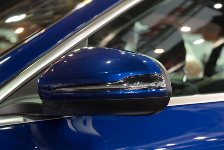 Rear view mirror of new blue car