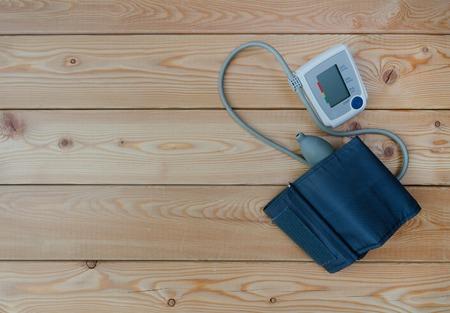 New digital tonometer on wooden table closeup