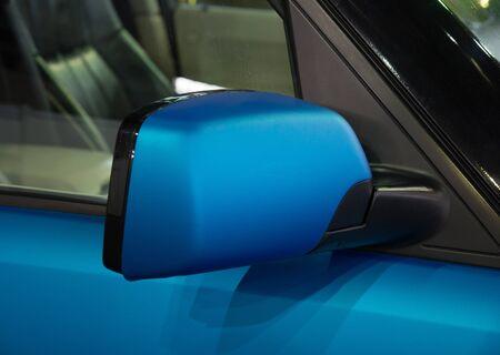 rear view mirror: Rear view mirror of new blue car