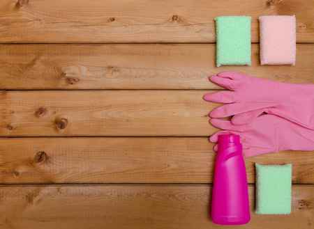 office cleanup: Set of variety cleaning supplies on wooden table, top view Stock Photo