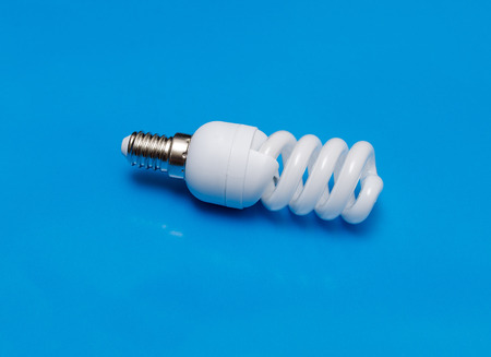 Modern energy saving   lamp on turquoise background.