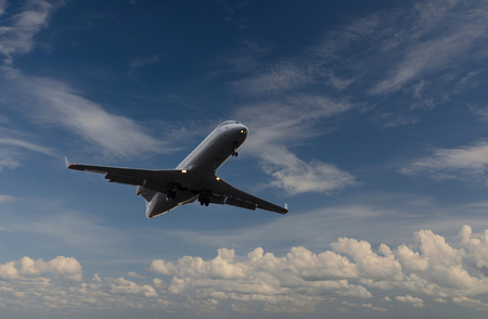 Airplane flying in sky with clouds at sunset time  Stock Photo